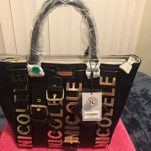 New purse Nicole lee black and gold
